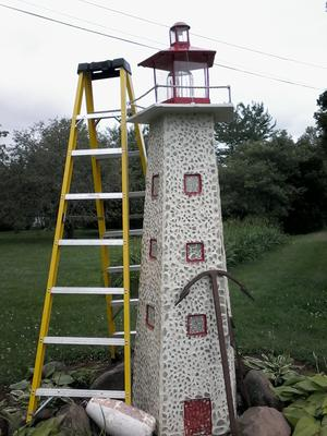 home made 8ft beach glass lighthouse