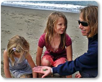 Mom and kids finding sea glass