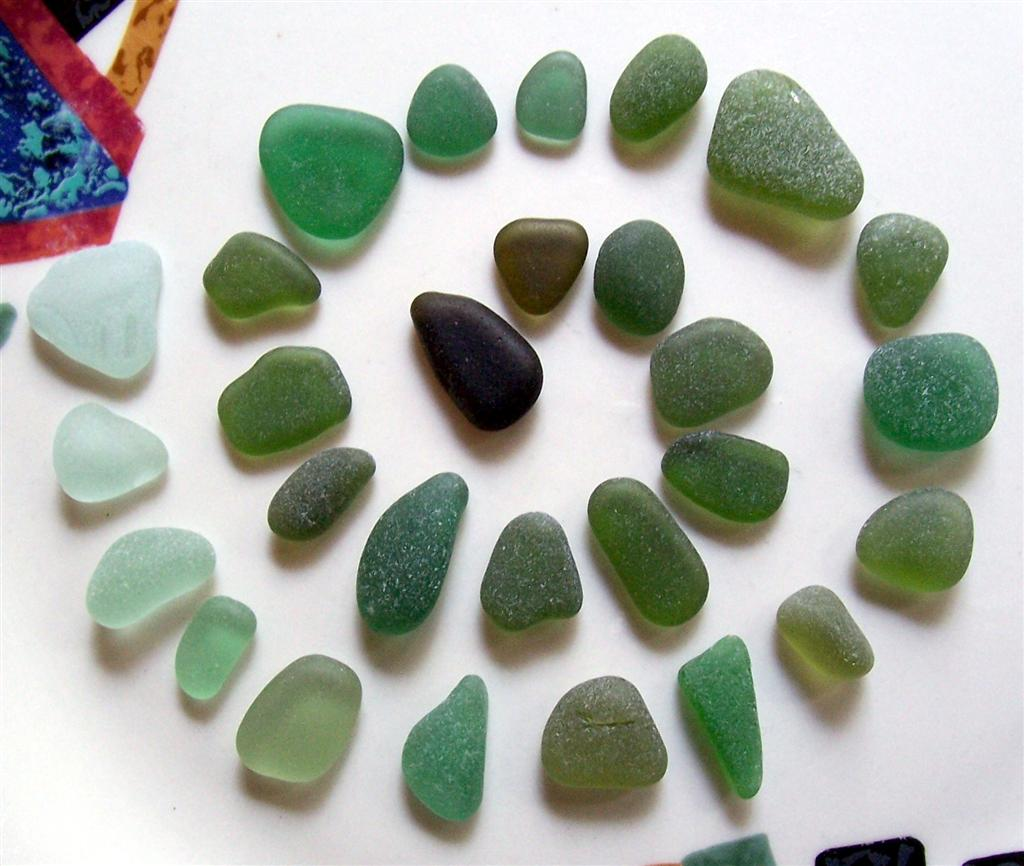 This spiral of green hues illustrates the variety you might find in green or turquoise sea glass.