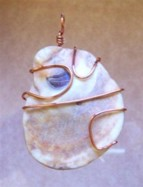 Shell wire wrapped in copper pendant