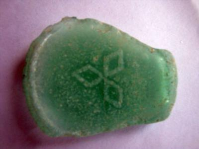 bottom 4: see symbol, diam. 52 mm, thick 3 mm, bright green