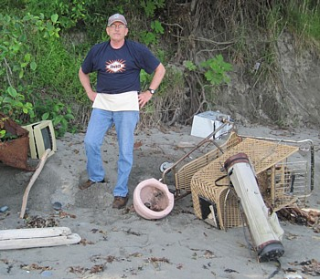 David looks at trash dumped over a 40-foot bluff.