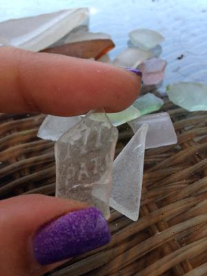 Identity, value or worth and any history on sea glass I'm holding that says something.