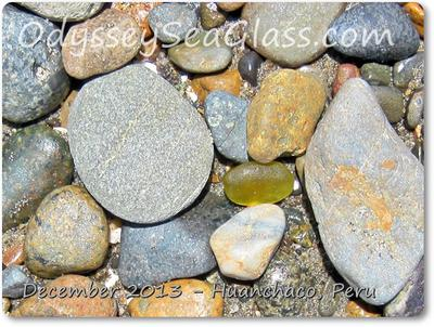 Unusual citron sea glass hiding under rocks - but didn't hide itself enough!