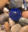 Blue sea glass orb looks like a gem