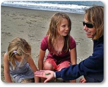 Claudia showing Kiley and Adrianna the Sea Glass
