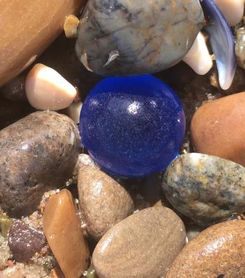 Blue sea glass orb looks like a gem