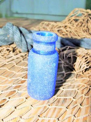 small cobalt blue old bottle