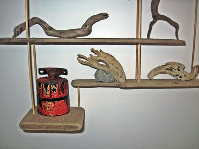 Bottom shelves driftwood and beach finds