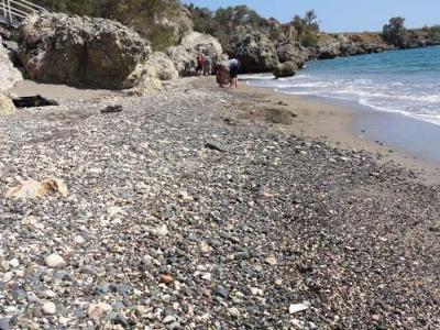 People collecting sea glass at Guantanamo Sea Glass Beach