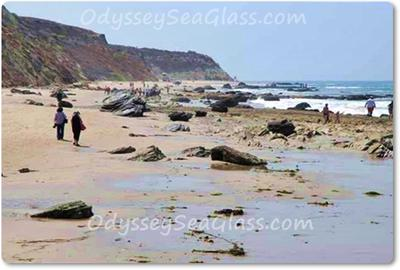 Less sand, more rocks and pebbles... and beach glass