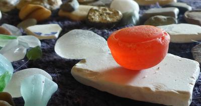My most Unique Beach Glass Find - Unknown Orange Half Sphere